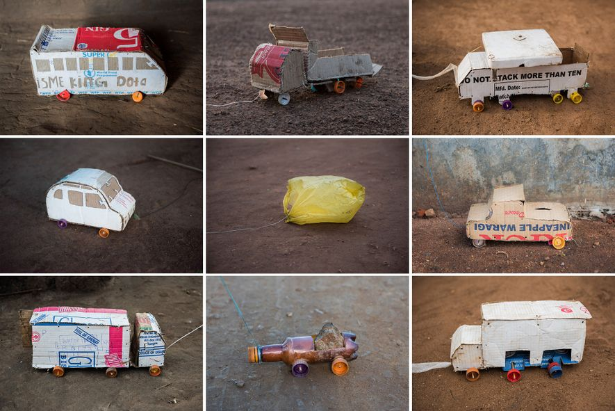 Cardboard boxes from shipments of humanitarian supplies get a second chance as toy cars, trucks, and buses.