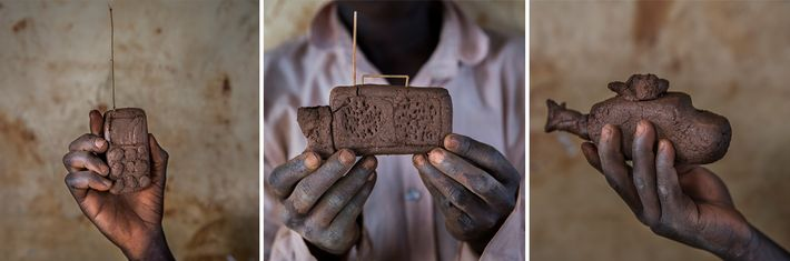 A mobile phone, a radio, and a helicopter, all made of mud, showcase the ingenuity of ...