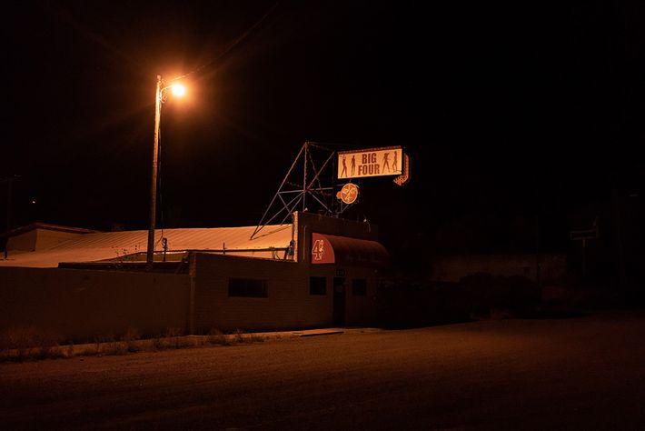 A street lamp casts Big Four Ranch in golden light. It is one of 21 legal ...
