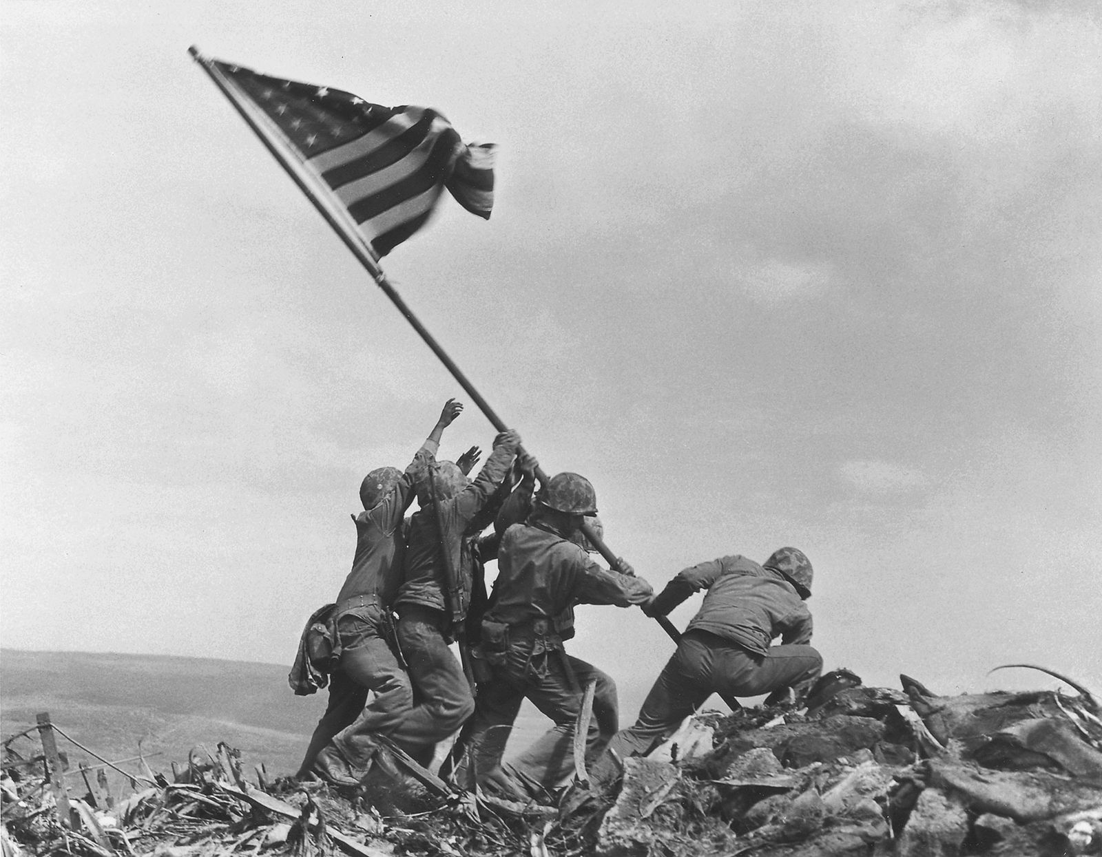 Five U.S. Marines and one Navy corpsman raise an American flag on Mount Suribachi on February ...