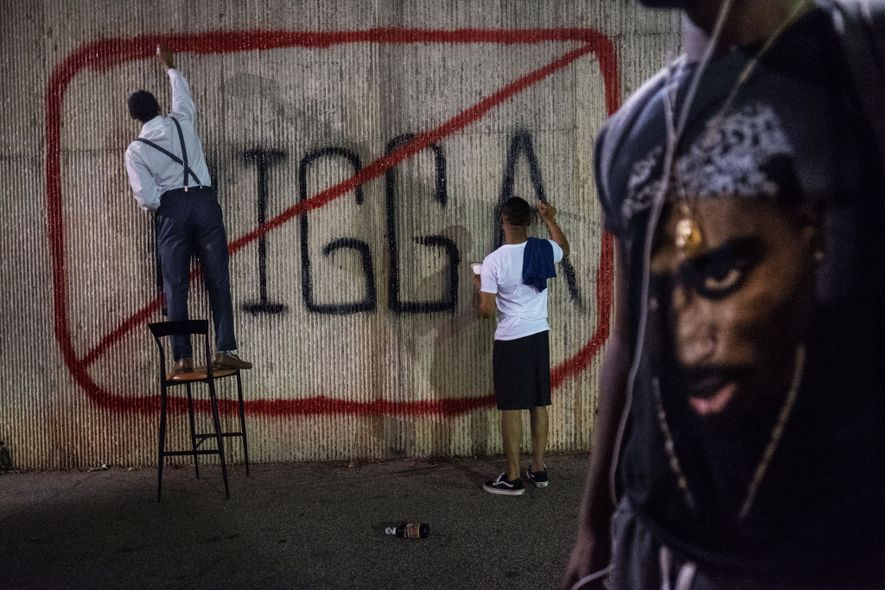 Morehouse College student government leaders John Cooper and Kamren Rollins paint a sign on campus to ...