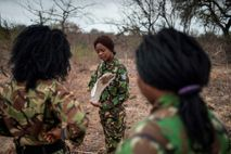 Members of the all-female Black Mamba Anti-Poaching Unit perform a routine patrol through a wildlife reserve ...