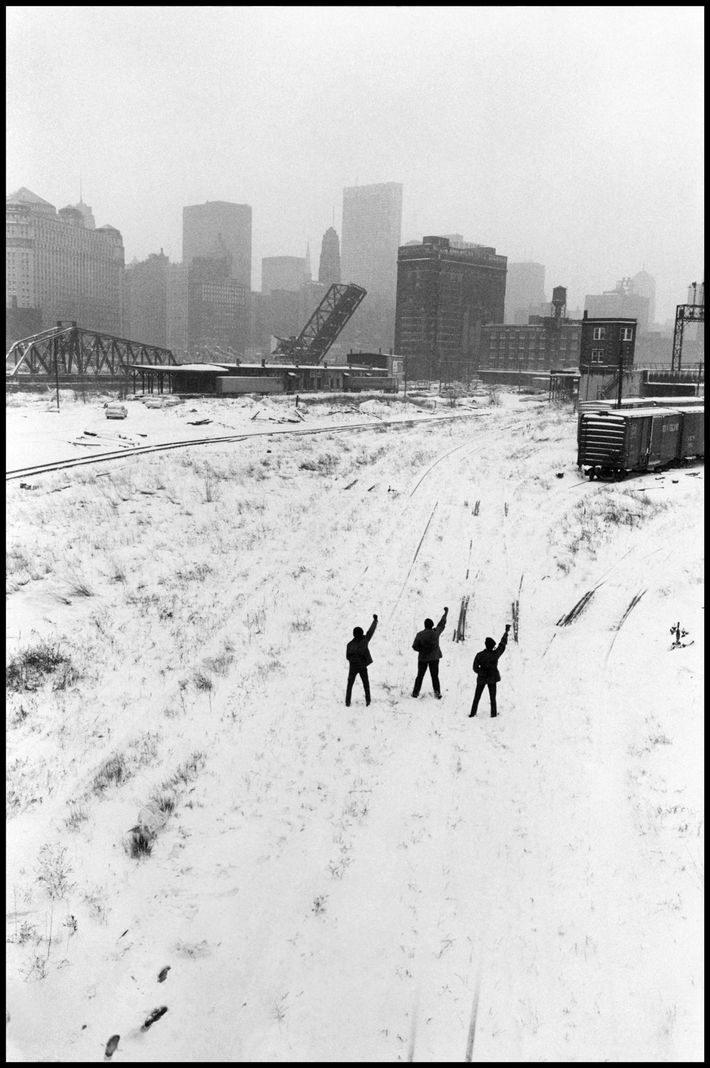 Members of the Black Panthers pose making the Black Power salute in a wintry Chicago train ...