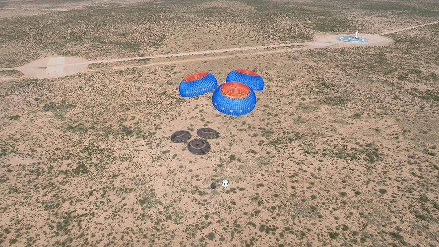 Parachutes bring Blue Origin's New Shepard crew capsule to a safe landing after an uncrewed test ...