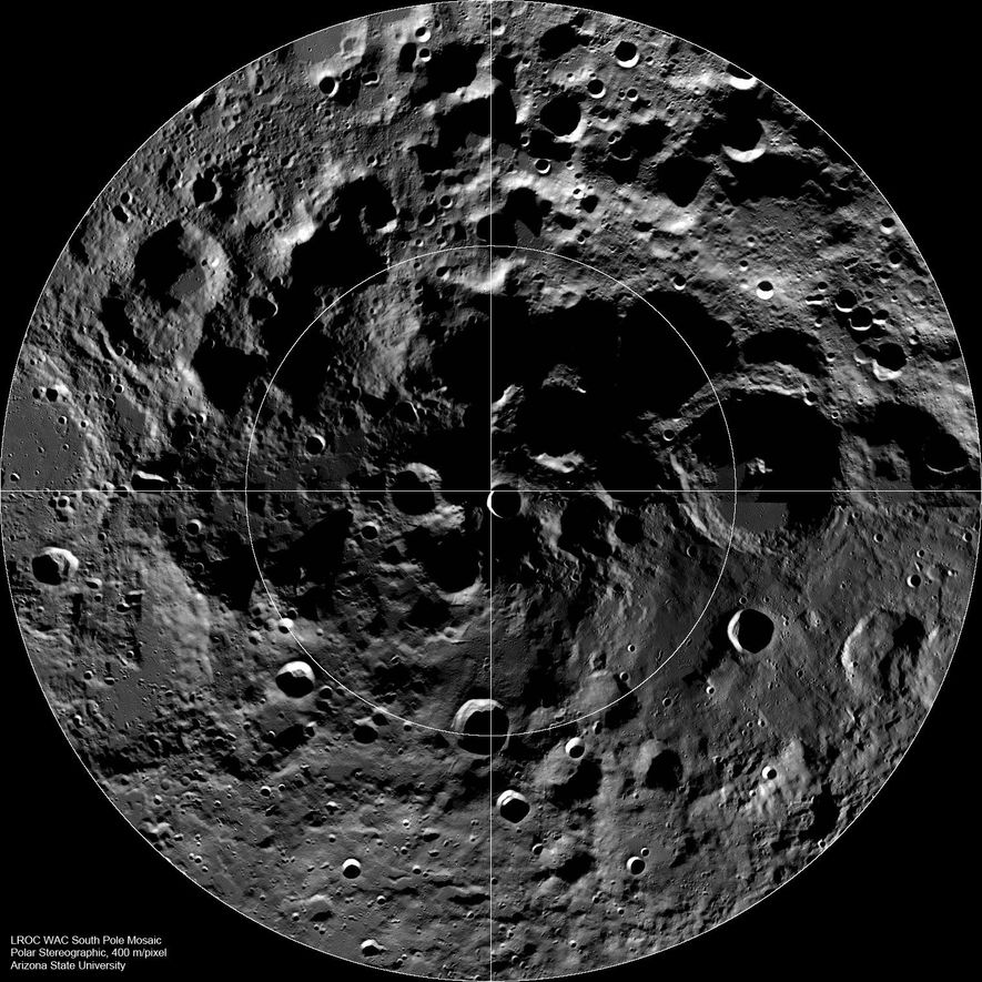 The mosaic image from the Lunar Reconnaissance Oribter shows the dark depths of shadowed craters on ...