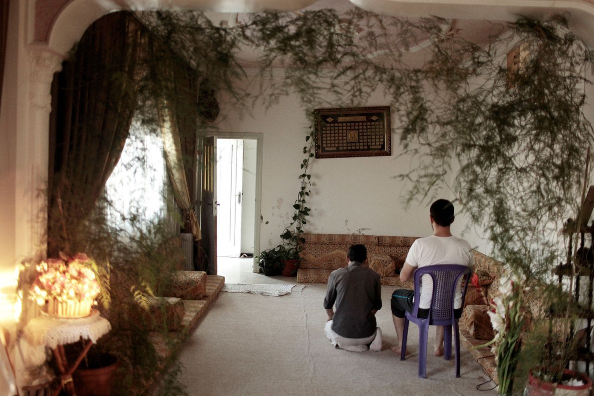 SYRIA. Homs. July 17, 2011. Anti-regime activists pray inside a safe house.