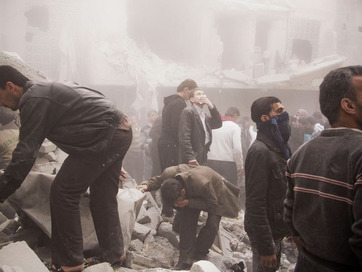 SYRIA. Aleppo. March 19, 2013. Aftermath of a regime airstrike in a residential building in the ...