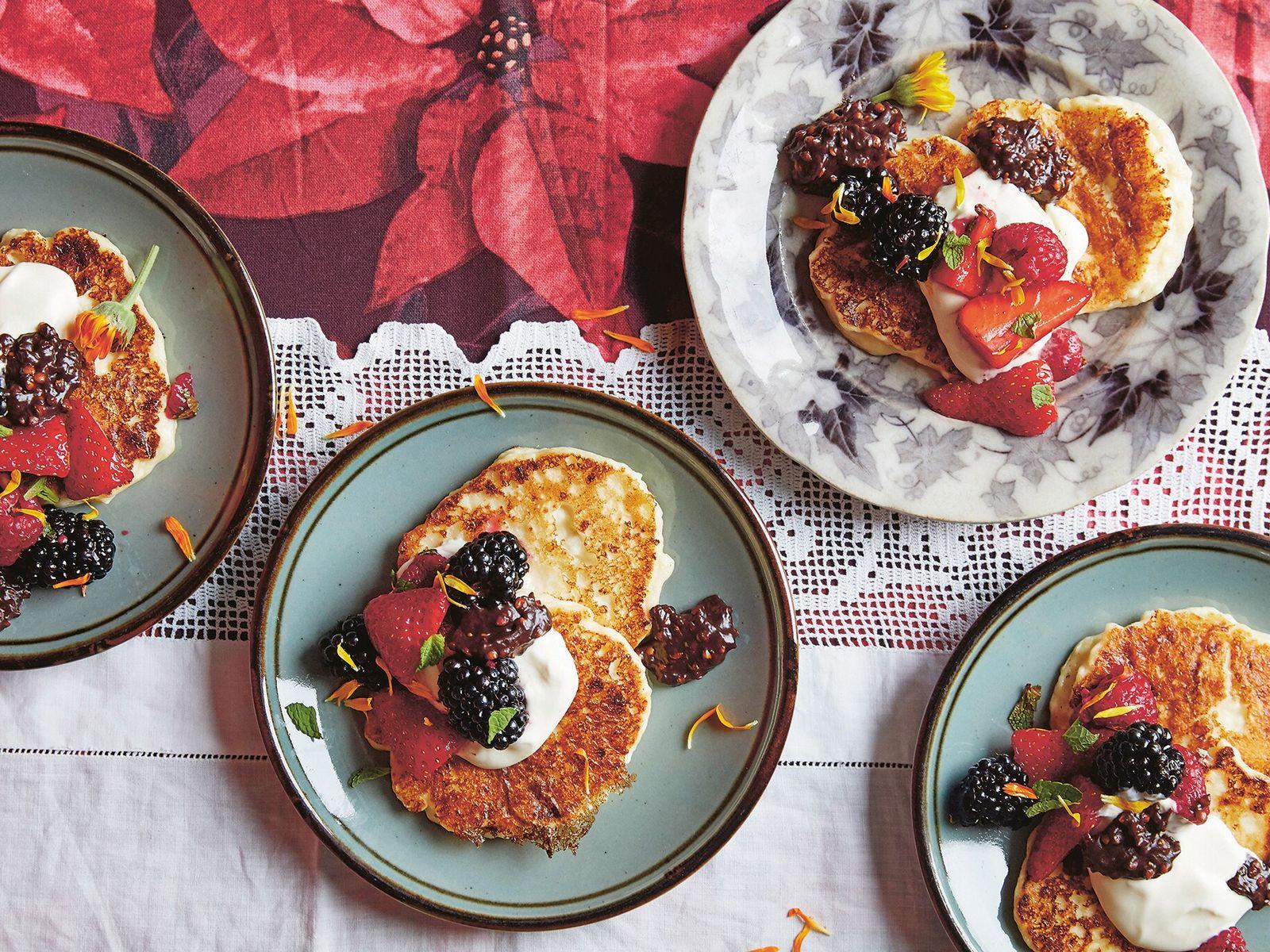 Syrniki pancakes with summer berry salad and chocolate buckwheat.