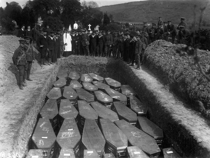 Servicemen attend the mass funeral held for victims in Ireland's County Cork. Of the 1,959 passengers ...