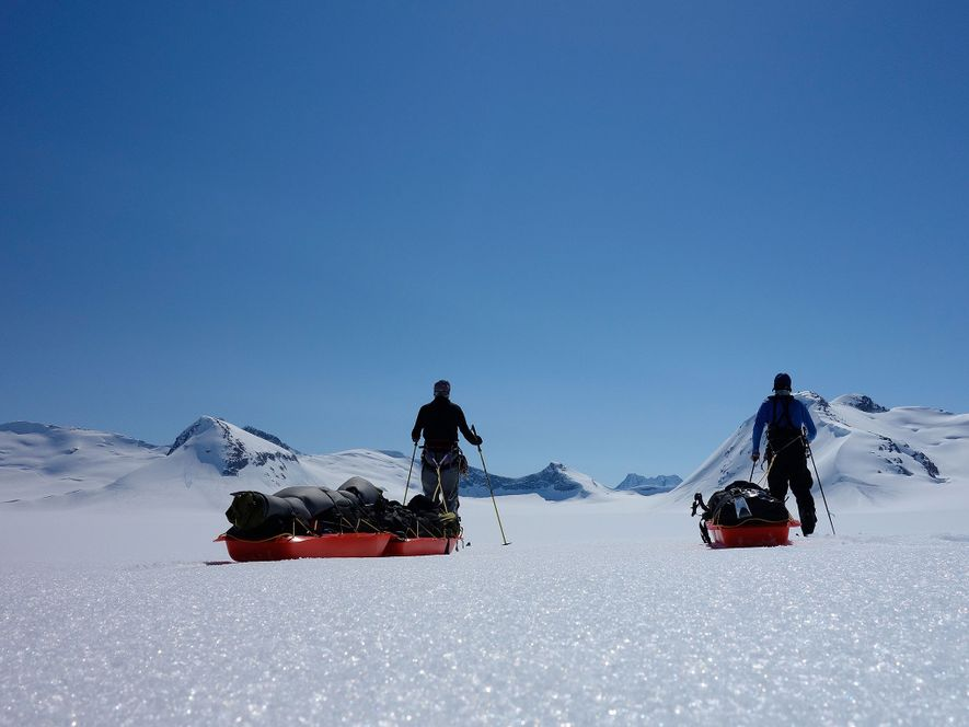 The pair pose for a self portrait on a clear day on the Stikine Icecap. While ...