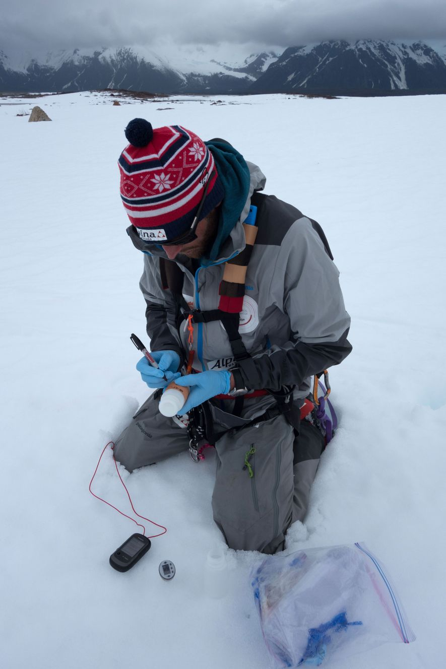 Colliard writes down positional information on a snow sample the team took for the the University of Anchorage. This information will be used to track the impacts of climate change on the ice caps.