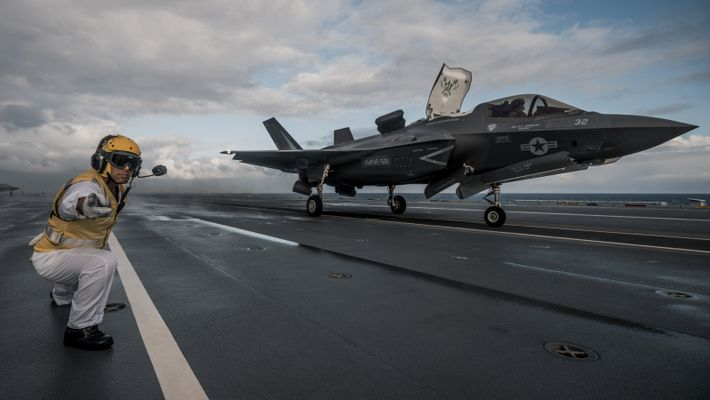 US Marine Corps F-35B Lightning jets landing onboard HMS Queen Elizabeth off the coast of the ...