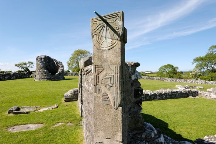 Sundials - such as this restored, early Christian period sundial at Nendrum Monastery, off the coast ...