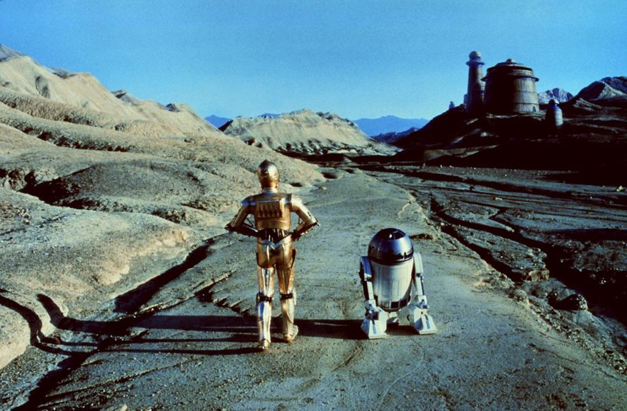 Iconic Star Wars robots C-3PO and R2-D2 approach the palace of Jabba the Hutt on the ...