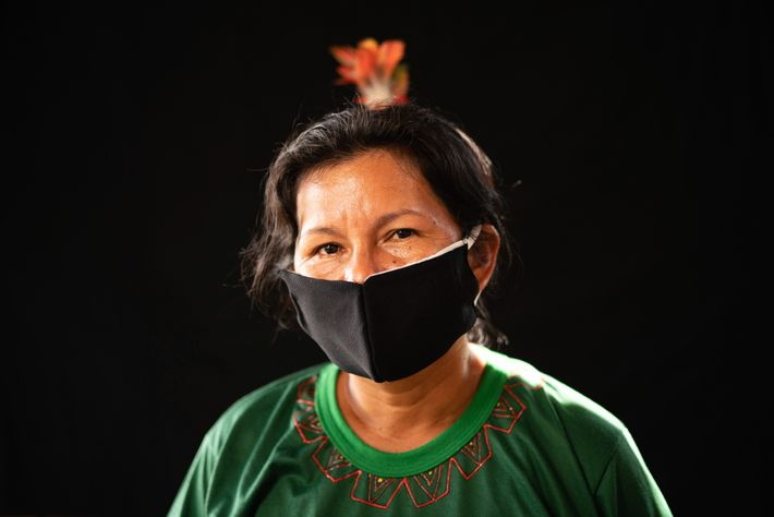 A member of the Karapanã ethnic group wears a hand-sewn face mask, hoping for protection against ...