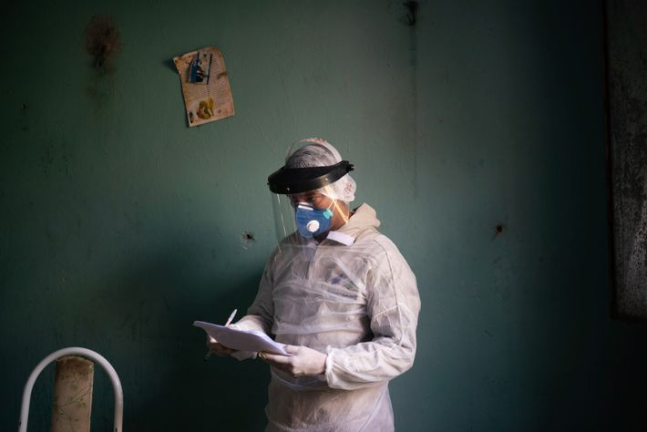 A government health-care worker prepares to conduct a COVID-19 test in Manacapuru, Amazonas. The state's four ...