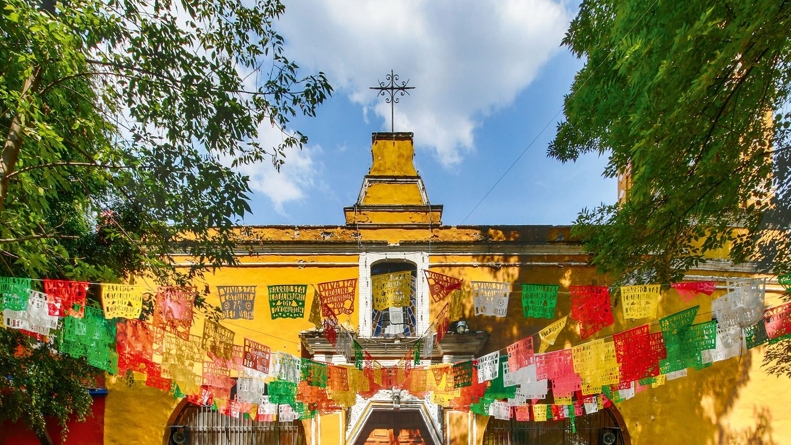 Built in the early Colonial period, Santa Catarina church in Coyoacán, Mexico City, is often festooned ...