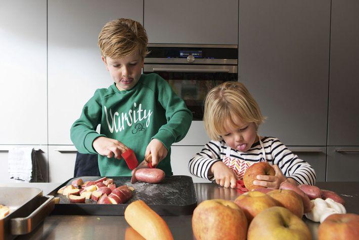 The children slice fruit and vegetables