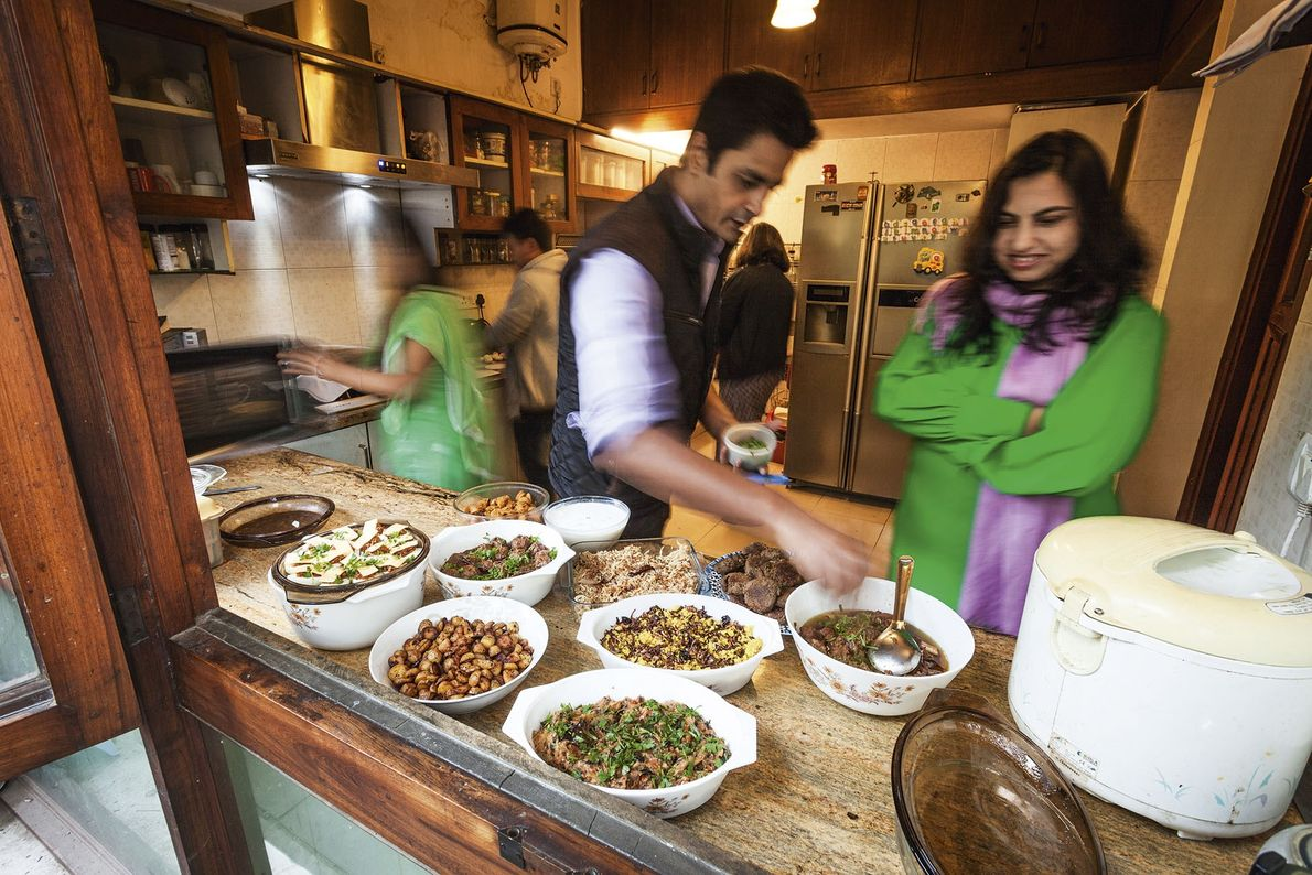 Manu Chandra sprinkles fresh coriander over the dishes.