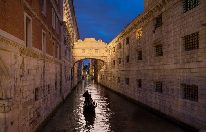 Visitors can take a gondola ride beneath the romantic Bridge of Sighs.