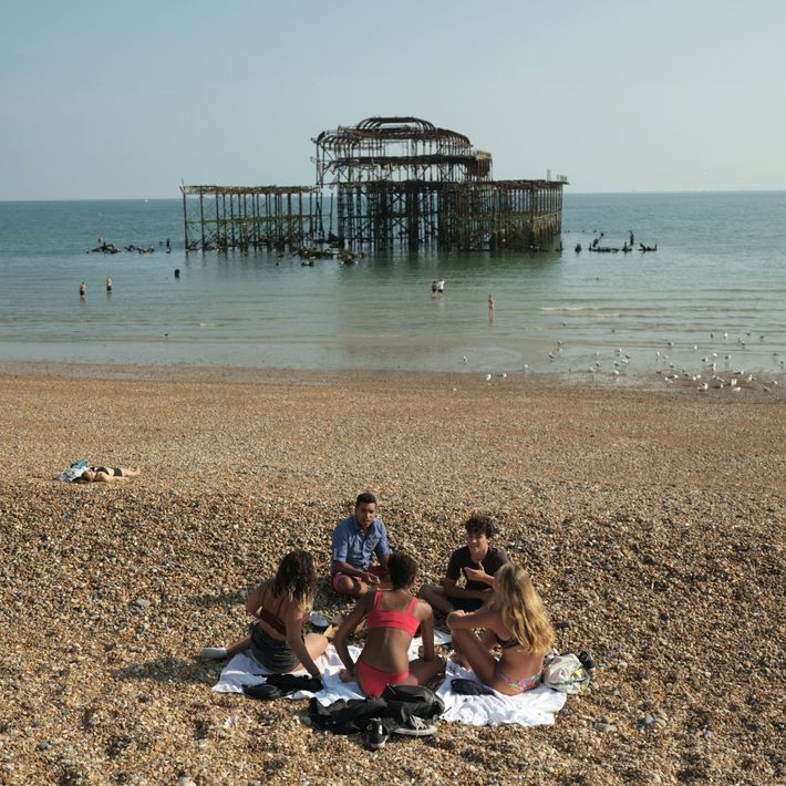 Life along the promenade on the shore of the Channel in Brighton city. Summer 2018 was ...
