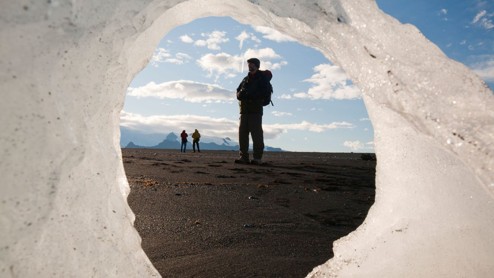 Observers regard melting ice in Jokulsarlon, Iceland. Climate change is one of five goals, or 'Earthshots', entrants are challenged ...