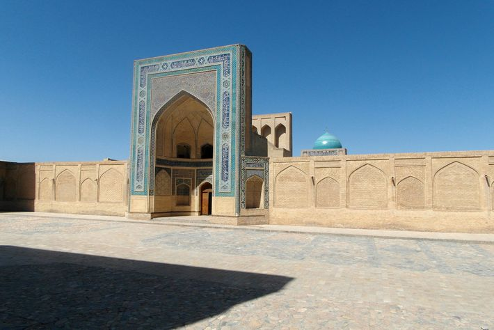 The entrance to Kalon Mosque overlooks a plaza in Bukhara, one of Central Asia's holiest cities, ...