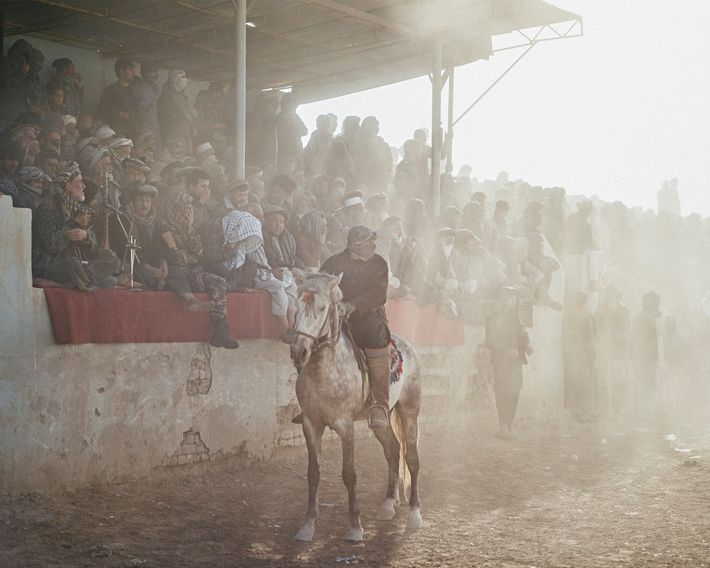 Spectators watch a match in Dawlatabad near the end of a long, hard-fought season. Buzkashi is ...