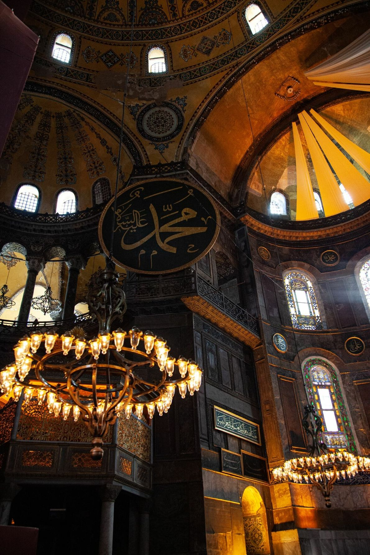 Depictions of Christian figures mingle with Koran verses inside the Hagia Sophia. The 6th-century church became ...