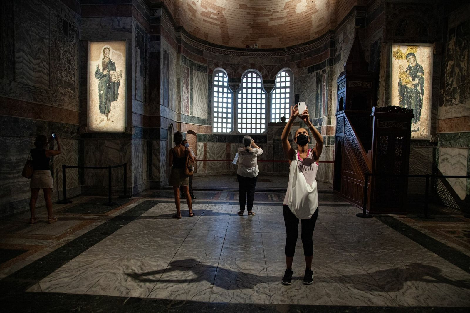 Tourists take photographs in the Byzantine-era Chora Church, which subsequently became a mosque under Ottoman rule ...