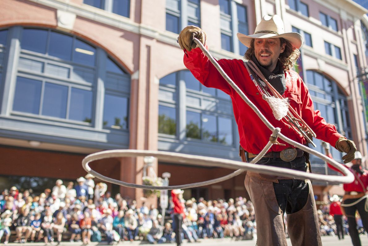 Entertainers delight hundreds of onlookers during the Calgary Stampede Parade. The event gives audiences an initial ...