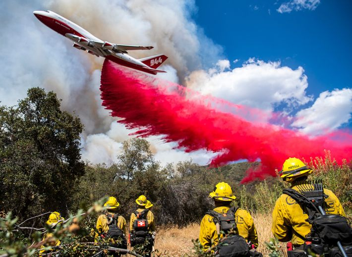 CAL FIRE's Boeing 747 air tanker drops flame retardant to slow the spread of the El ...