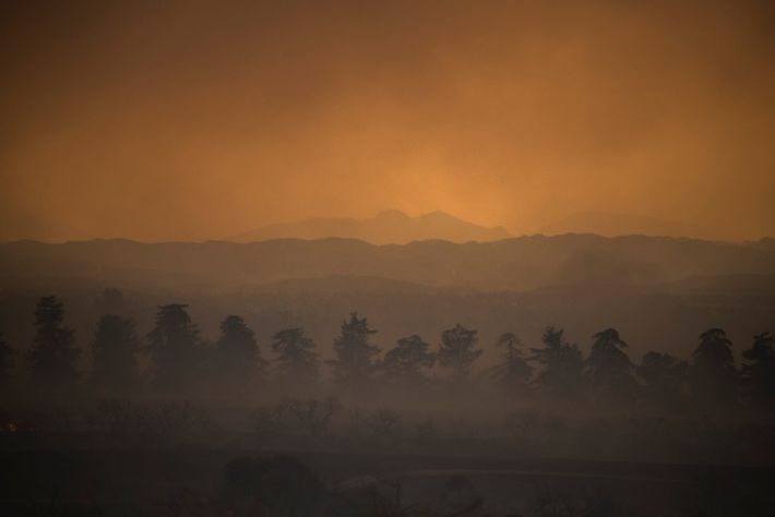 Smoke from the El Dorado Fire glows in the sunset over the San Bernardino National Forest ...