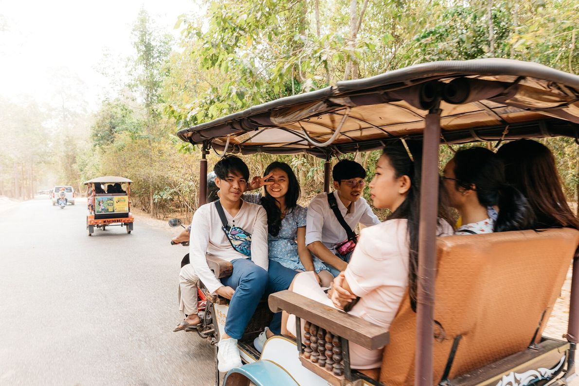 Exploring the archaeological park is best done by tuk-tuk; with miles of dense, humid forest to pass ...
