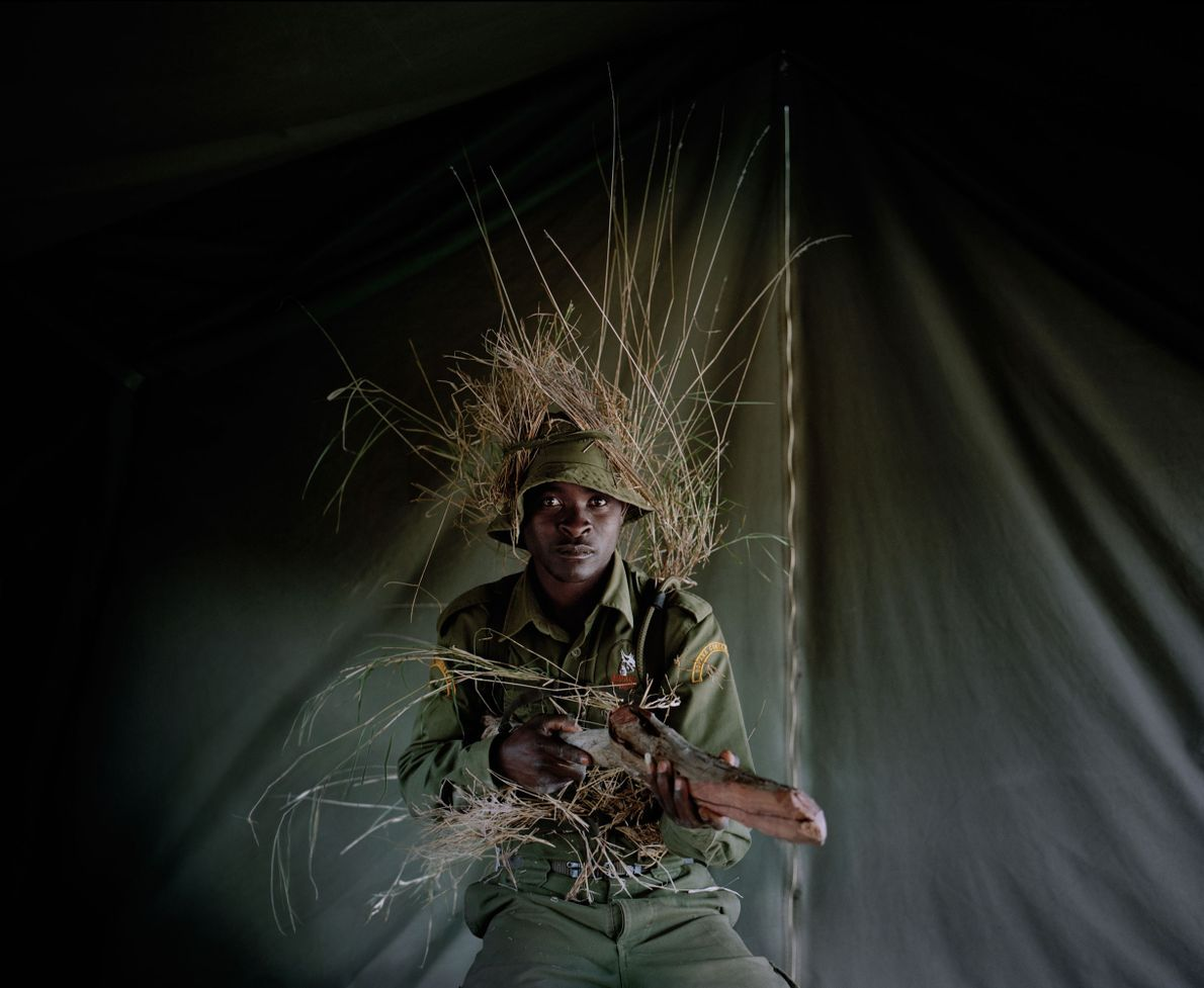 A conservancy ranger-in-training learns the art of camouflage at Borana Ranch, northern Kenya. The warriors are ...