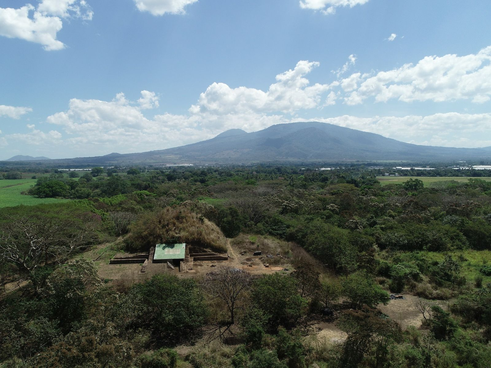 In El Salvador, excavation of a Maya pyramid (foreground) has revealed a surprising connection to the ...