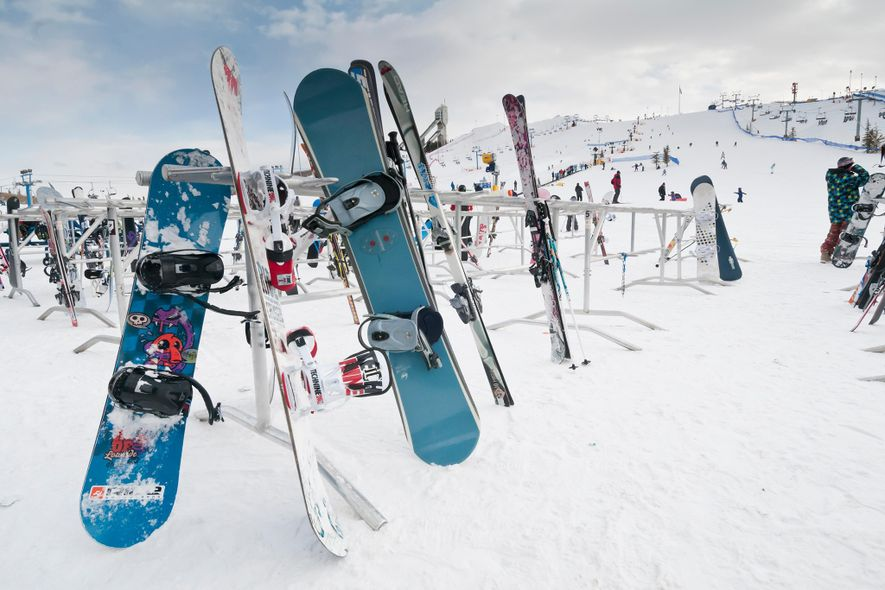 Snowboards and skis rest on a rack at Canada Olympic Park in Alberta, Canada.