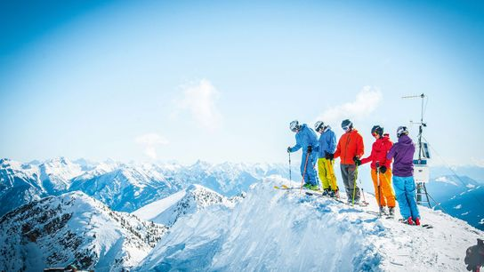 Skiers on a drop-in, Kicking Horse, Canada