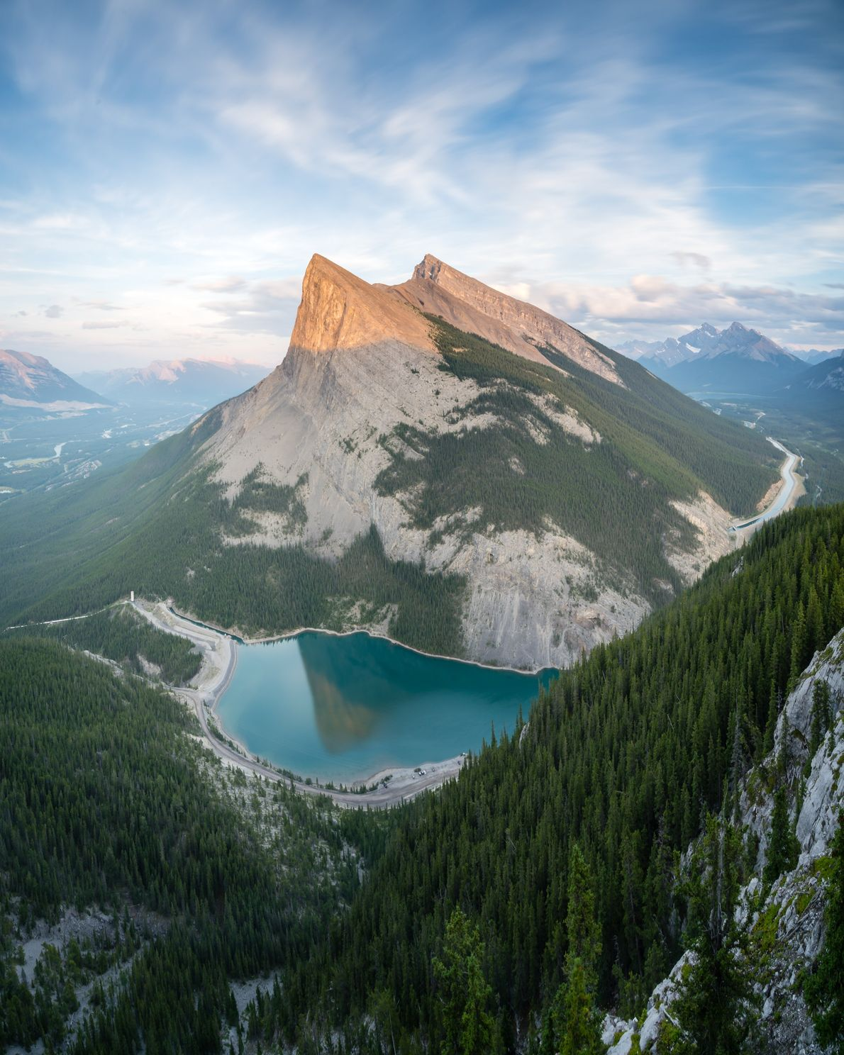 Sunset from high above Canmore, Alberta. The two mountains are part of the Canmore Triple Crown ...