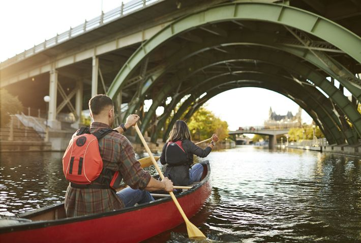 Canoeing along the Rideau Canal, a UNESCO World Heritage Site.