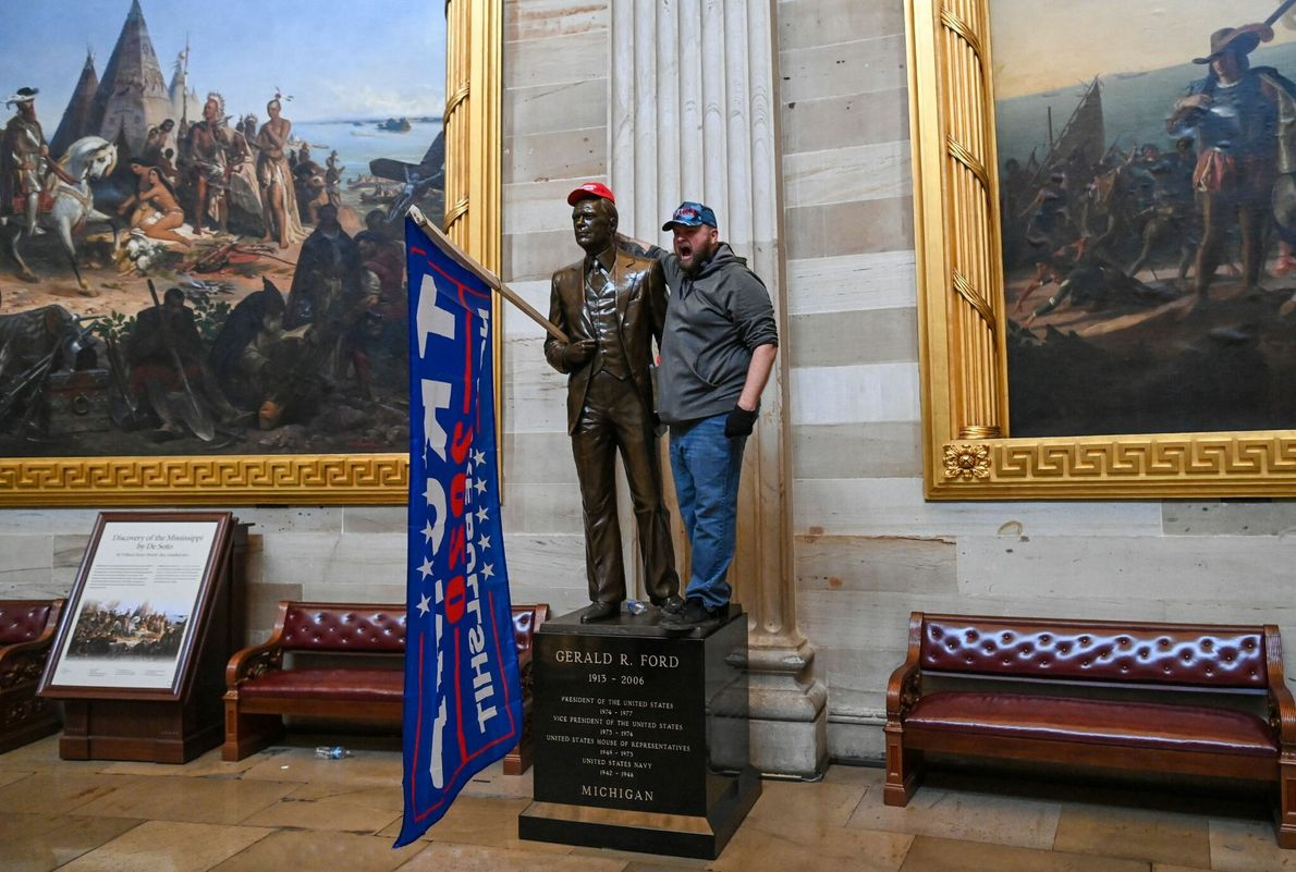 Rioters had free reign to roam inside the US Capitol's Rotunda, taking photos and searching through ...