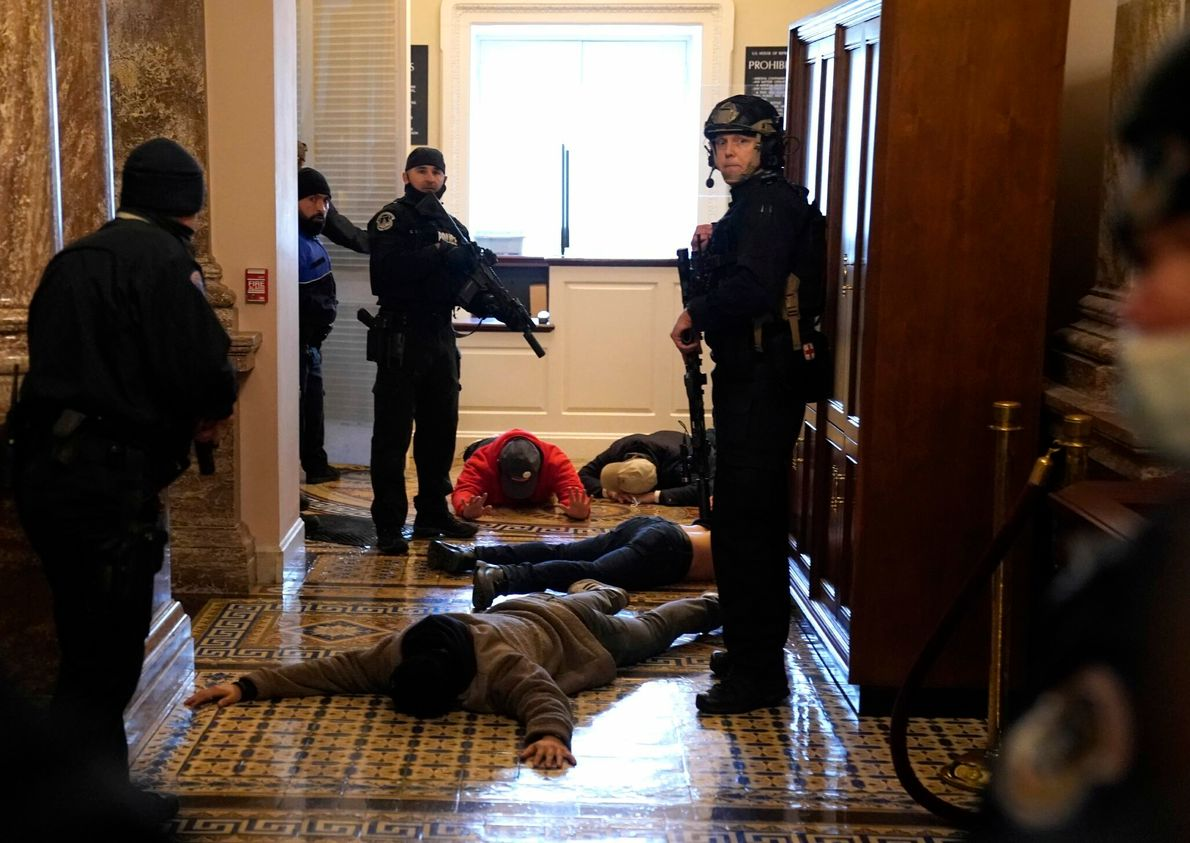 U.S. Capitol Police detained rioters outside of the House Chamber. One woman was reportedly shot by ...