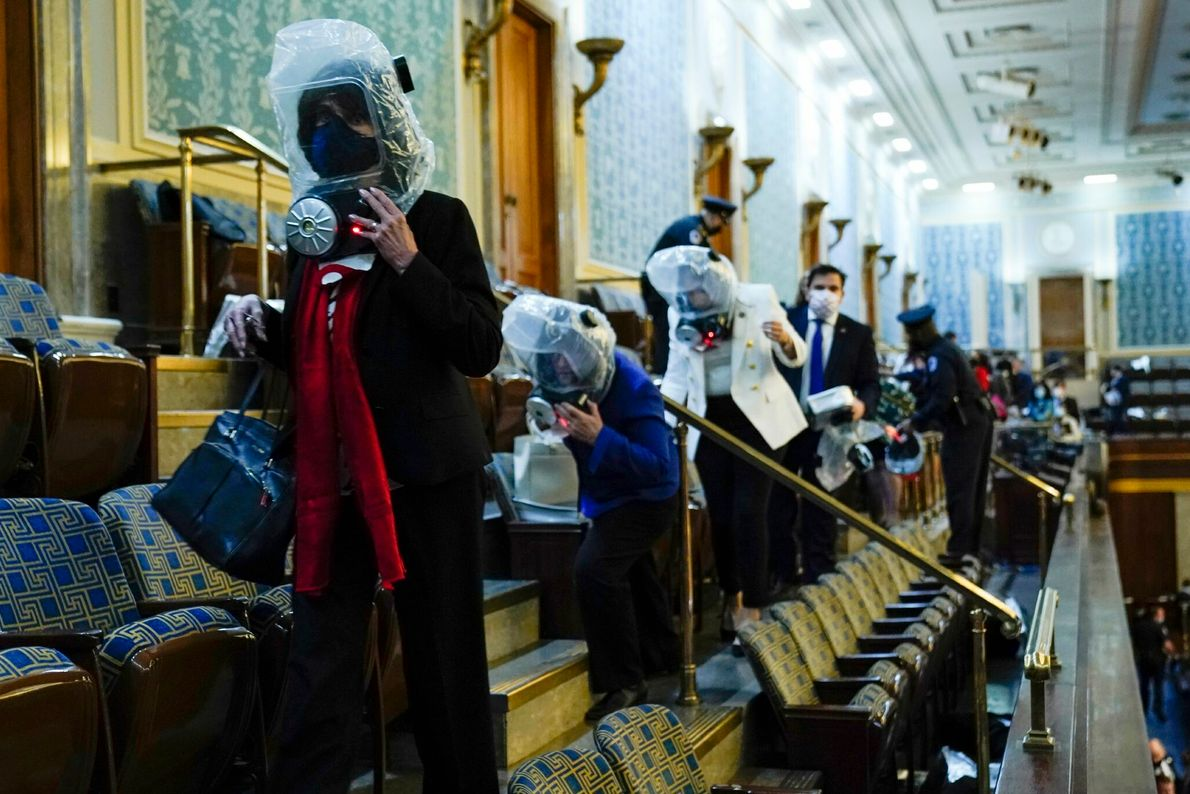 As supporters of President Trump forcefully entered the Capitol, lawmakers and staffers in the House gallery ...