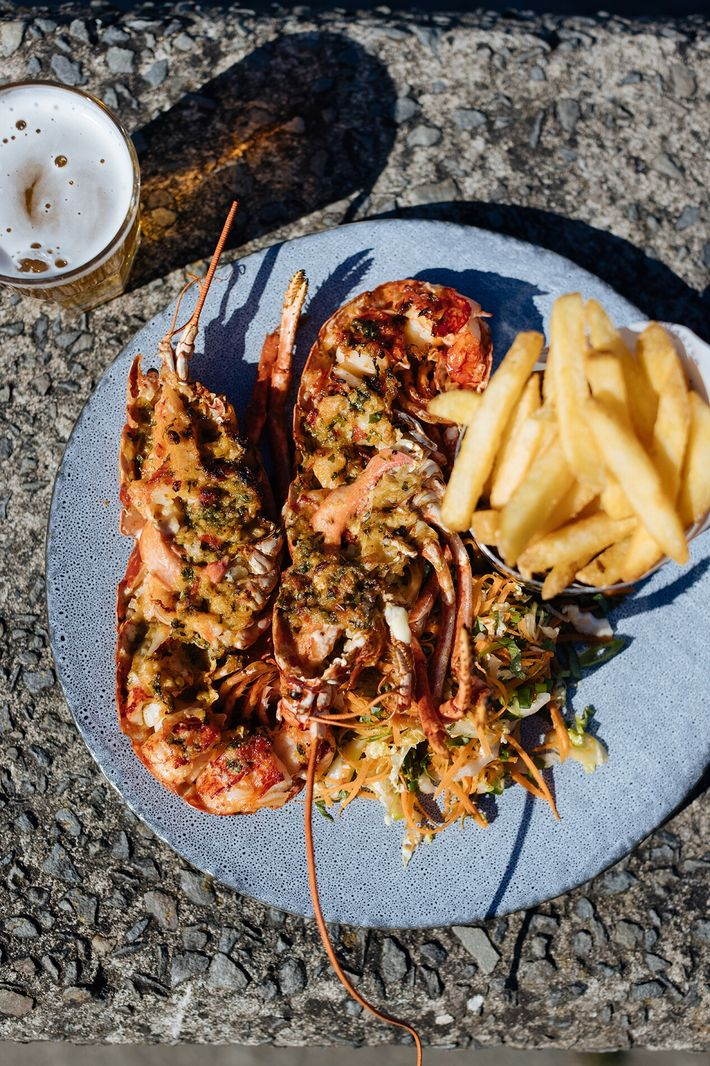 Lobster, chips and a beer at the Harbourmaster Hotel. Themenu of the hotel remains decidedly local.