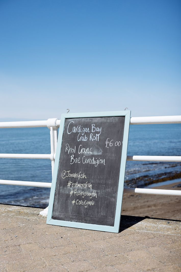 The sign near the trailer for Jonah's Fishmongers on Aberystwyth seafront.
