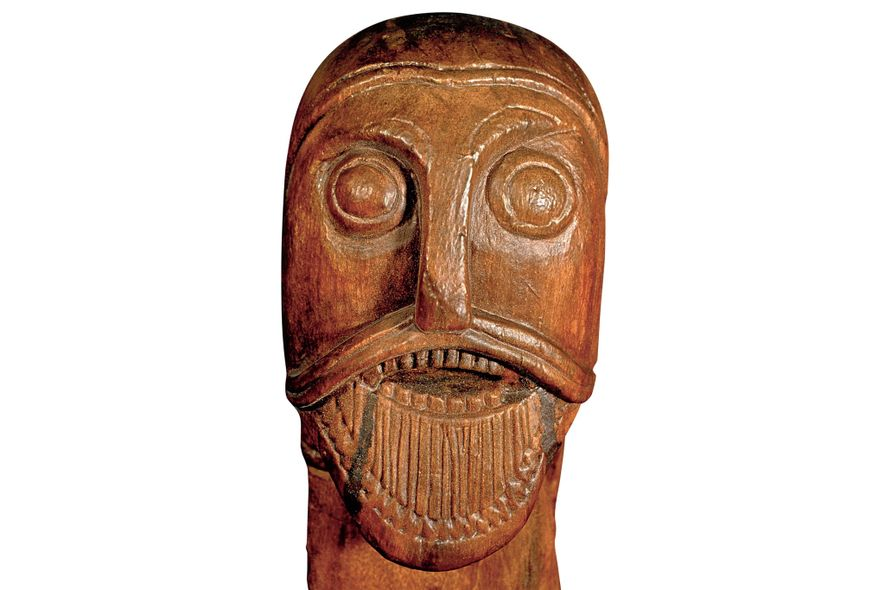 A carved head on the funerary cart found at Oseberg.