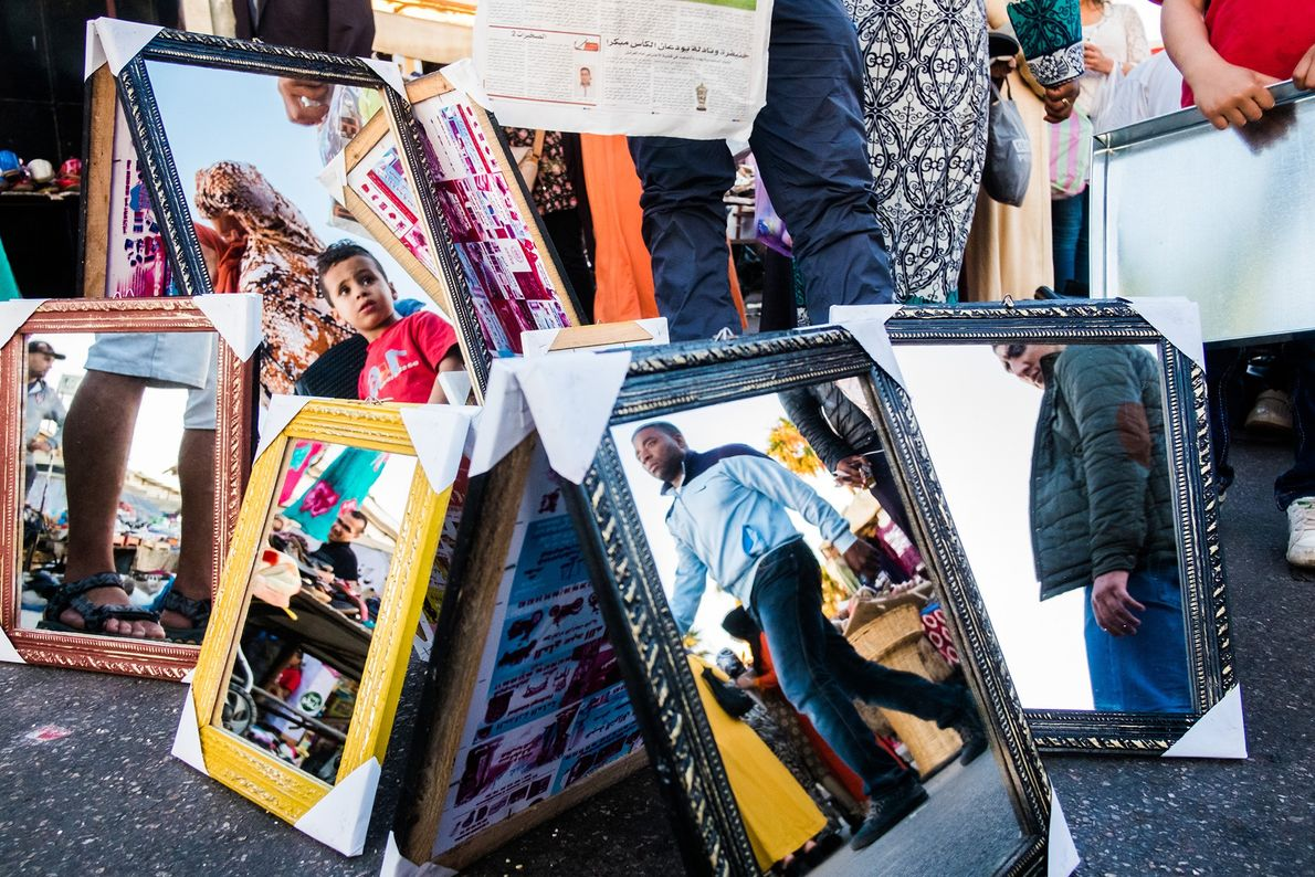 Mirrors reflect those looking for bargains in the flea market in the Hay Hassani neighbourhood.