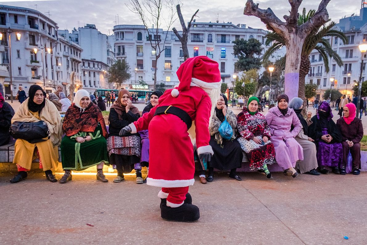 Santa greets the crowd at Marechal Square. The second-largest religion in the country is Christianity, but ...