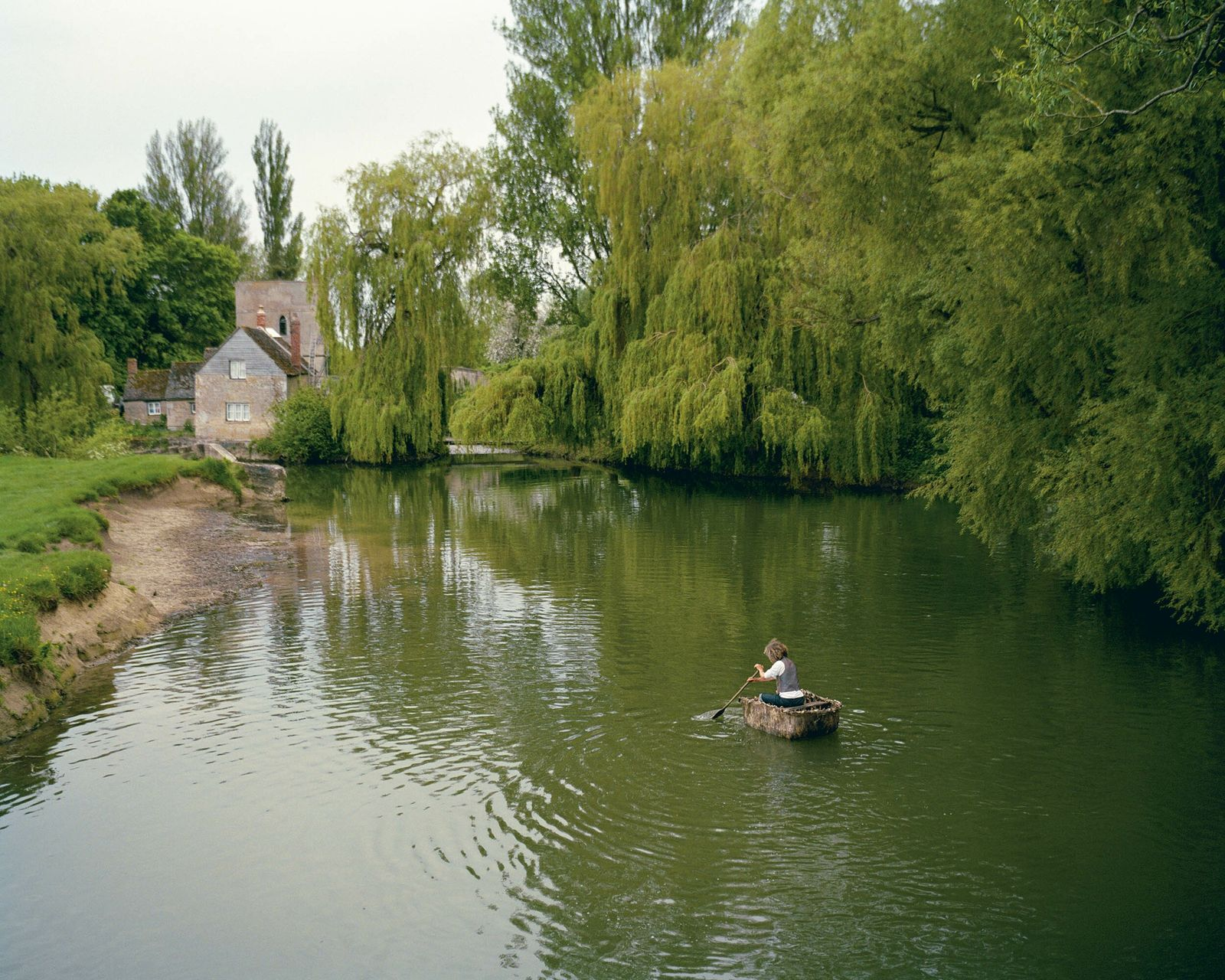 Lechlade, Gloucestershire: Druid Chris Parks in a self-built coracle which he used to row the Thames from ...