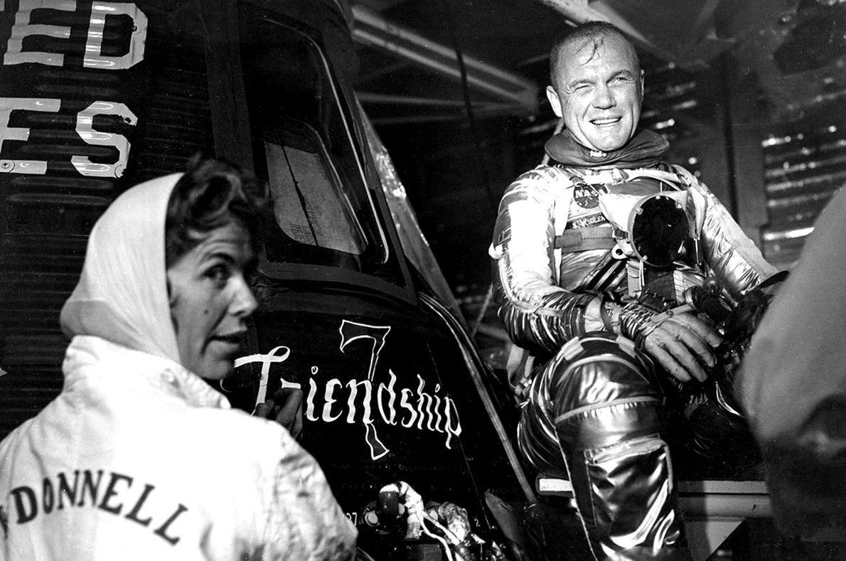 Chrysler Aerospace artist Cecelia Bibby paints Friendship 7 on NASA astronaut John Glenn's Mercury spacecraft. All ...